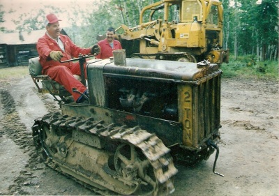 Deputy Chief Taylor drives the pre-restoration Caterpillar